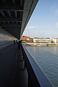 Promenade on the bridge of the Slovak National Uprising (Slovak officially Most SNP) with Danube and house fronts, Bratislava, Slovakia