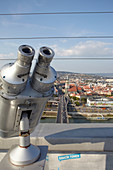 View from UFO observation deck with binoculars, Bratislava, Slovakia.