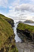 Natural harbor from the fishing village Gjógv with impressive landscape, Gjógv, Faroe Islands