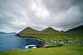 View from the steep coast to the sea and the mountains around Gjógv, Faroe Islands.