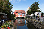 "Restored half-timbered house above the artificial watercourse ""fresh pit"" in the old town of Wismar, Mecklenburg-Western Pomerania, Germany"