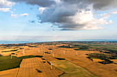 View from the balloon over harvested fields to the Baltic Sea, Ostholstein, Schleswig-Holstein, Germany