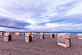 Beach chairs on the beach of Großenbrode in the evening light, Baltic Sea, Ostholstein, Schleswig-Holstein, Germany