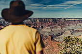 Man looks out into the Grand Canyon, Grand Canyon National Park, Arizona, USA, North America
