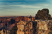 Photographer stands at the rim of the Grand Canyon, Grand Canyon National Park, Arizona, USA, North America