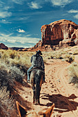 Horseback riding in the Navajo area in Monument Valley, Arizona, Utah, USA, North America