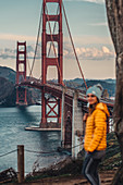 Woman standing in front of Golden Gate Bridge, San Francisco, California, USA, North America, America