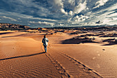 Person running in Coral Pink Sand Dunes State Park, Utah, USA, North America