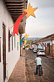 house facades decorated for Christmas in old town of Barichara, Departmento de Santander, Colombia, South America