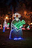 illuminated indogenous figure made from plastic bottles at night, Parque Principal, Barichara, Departmento de Santander, Colombia, South America