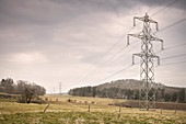 """Industrial monument """"historic electricity pylons"""", in a snow storm, Swabian Alb, Baden-Wuerttemberg, Germany, Europe"""
