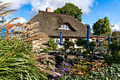 House and outdoor dining area of the Café Rosengarten in Zingst, Mecklenburg-Western Pomerania, Germany.