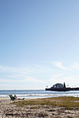 Man in beach chair overlooking Stearns Wharf in Santa Barbara, California, USA: