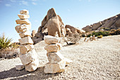Stone towers against the backdrop of Jumbo Rocks in Joshua Tree Park, California, USA.