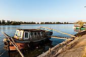 Rusty boat in the Danube Delta in the evening sun, Mila 23, Tulcea, Romania.