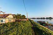 Fisherman's house in the Danube Delta in the evening sun in April, Mila 23, Tulcea, Romania.