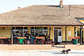 Danube Delta: Men sit in front of the village restaurant in Mila 23, Tulcea, Romania.