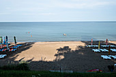Black Sea Coast: Sunbeds and umbrellas on the beach, Olimp, Constanta County, Romania.