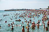 Black Sea Coast: Bathers on Eforie Nord Beach, Constanta County, Romania.