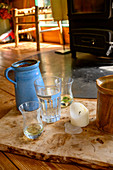 Water jug with glasses in alternative living space, live and live in a construction trailer