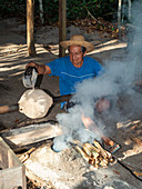 Man processes raw rubber, indigenous people on the Amazon near Manaus, Amazon basin, Brazil, South America