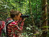 Tourist photographed in the Amazon rainforest near Manaus, Amazon Basin, Brazil, South America