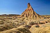 Ocher colored cone of erosion, Bardenas Reales, Bardenas Reales Natural Park, UNESCO Bardenas Reales Biosphere Reserve, Navarra, Spain