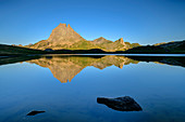 Pic du Midi d'Ossau reflected in mountain lake, Lac Roumassot, Pyrenees National Park, Pyrénées-Atlantiques, Pyrenees, France