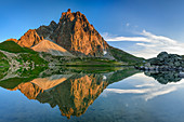 Pic du Midi d'Ossau reflected in mountain lake, Lac de Pombie, Pyrenees National Park, Pyrénées-Atlantiques, Pyrenees, France
