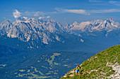 Woman hiking up to Soiernspitze, Wetterstein in the background, Soiernspitze, Karwendel, Upper Bavaria, Bavaria, Germany