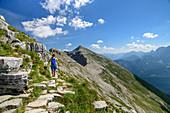 Woman hiking climbs to Soiernspitze, Soiernspitze, Karwendel, Upper Bavaria, Bavaria, Germany