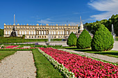 Park with flower borders and Herrenchiemsee Palace, Herrenchiemsee, Chiemsee, Upper Bavaria, Bavaria, Germany