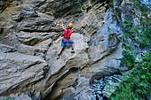 Woman commits Möllschlucht via ferrata, Möllschlucht, Glockner Group, Hohe Tauern, Hohe Tauern National Park, Carinthia, Austria