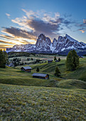 The first sunlight squints on the landscape on the Alpe di Siusi in South Tyrol, Italy