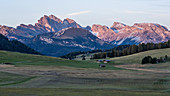 Sunset on the Alpe di Siusi in South Tyrol with a view of the surrounding mountain landscapes