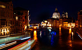 Nocturnal boat traffic on the Grand Canal, Venice, Veneto, Italy