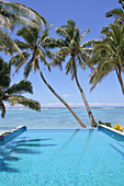 Empty swimming pool in a tropical island resort on a bright clear day in Rarotonga , Cook Islands.