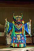 A dancer wearing a traditional costume and traditional mask during a cultural performance in Ulaanbaatar, Mongolia.