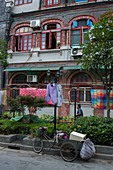 Street scene with a bicycle and laundry drying in the former Jewish neighborhood in the Tilanqiao Historic Area of Hongkou district of Shanghai, China.