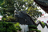 The dragon wall at the Yu Garden or Yuyuan Garden, which is an extensive Chinese garden located beside the City God Temple in the northeast of the Old City of Shanghai, China.