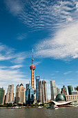 View from a Huangpu River cruise of the modern center of Pudong with the Oriental Pearl Television Tower and the 492 meter high World Financial Center, Shanghai, China.