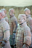 Warrior statues in the Terracotta Warriors and Horses Museum, displaying the collection of terracotta sculptures depicting the armies of Qin Shi Huang (259 BC - 210 BC), the first Emperor of China, in Xian, China.