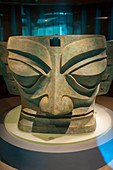 A bronze mask from the 12th century BC in the exhibit of ancient artifacts at the Sanxingdui Museum in Sanxingdui near Chengdu, Sichuan Province in China.