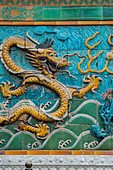 Detail of a dragon at the Nine-Dragon Wall (Nine-Dragon Screen) at the Forbidden City, in Beijing, China.