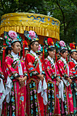 The restaurant staff of the Bai Jia Da Yuan Restaurant in Beijing, China dressed in historic costumes.
