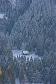 Lonely chalet under snow in winter in Val d'Illiez near Champery, Switzerland