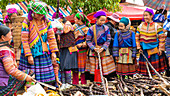 Flower Hmong tribes people at market, women buying sugar cane. Bac Ha market, Lao Cai province, Vietnam.