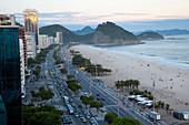 High-angle view of Copacabana Beach, and Avenue Atlantica at dusk, Copacabana, Rio de Janeiro, Brazil