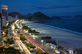 Copacabana Beach, and Avenue Atlantica at night, Copacabana, Rio de Janeiro, Brazil
