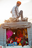 Passengers in an off-road vehicle in Pushkar, Rajasthan State, India